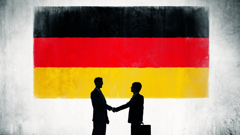 Business People Shaking Hands With Flag of Germany